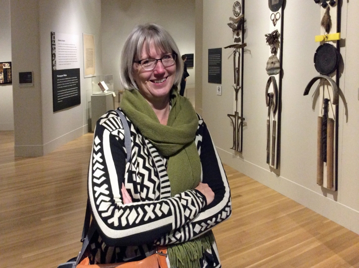 Julie both smiling and shedding a tear as she leaves the exhibition