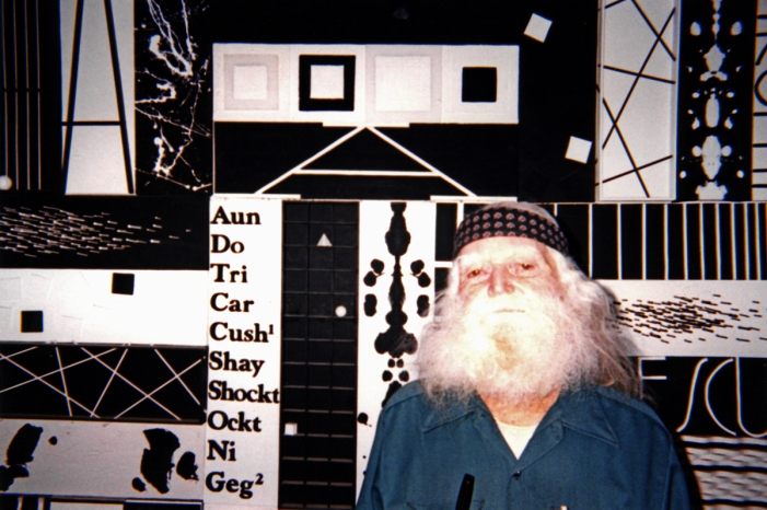 Jim at home with his art, circa 1999